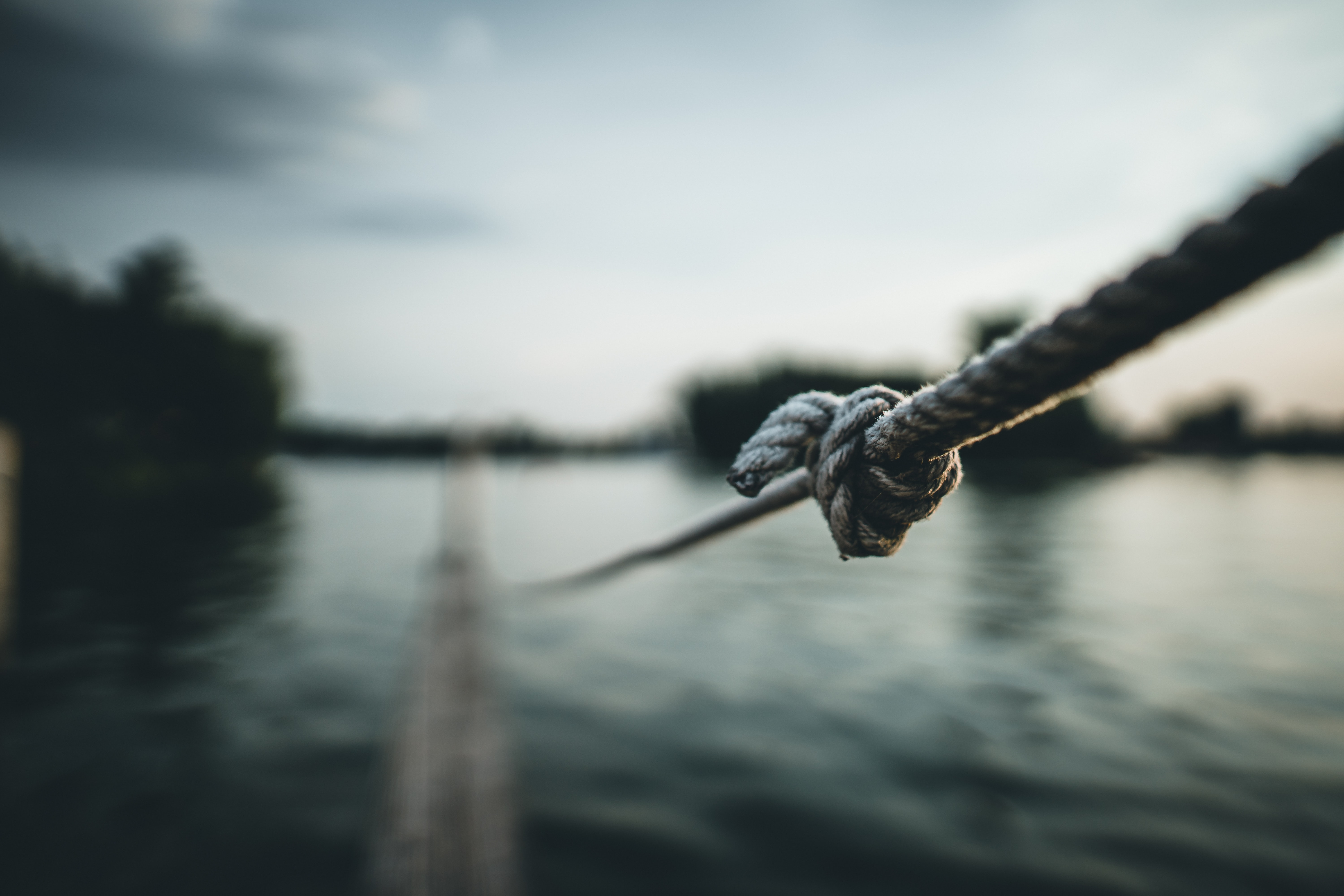 selective focus photography of gray rope