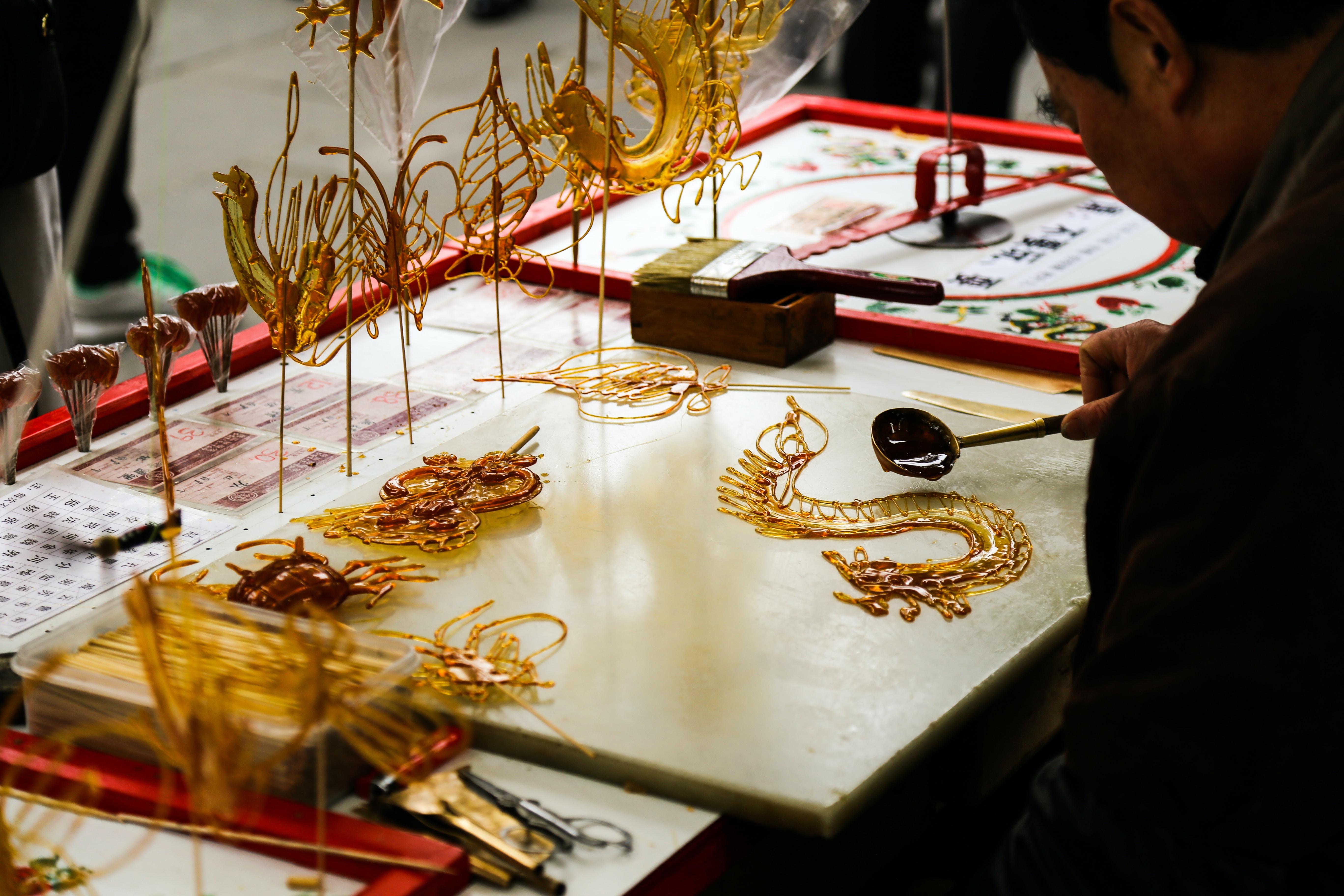 man doing dragon art on table