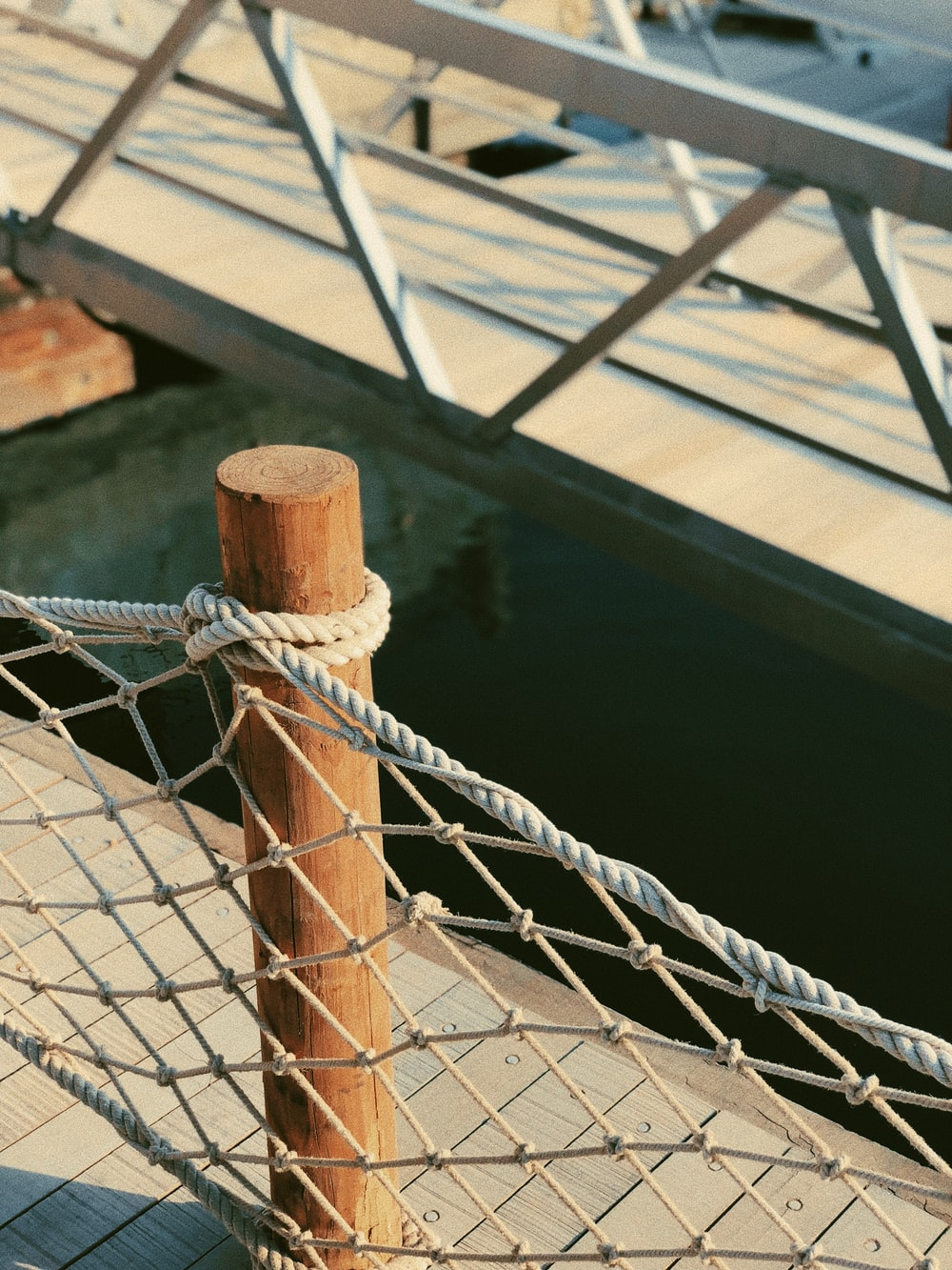 close-up photo of gray rope fence