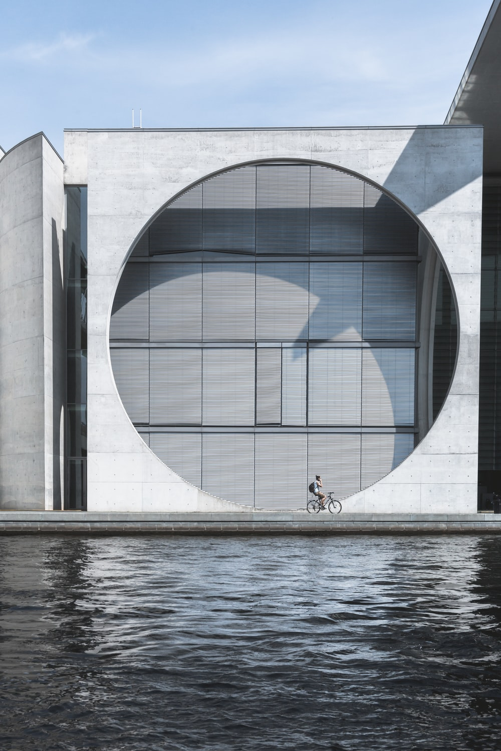 person riding on bike near water