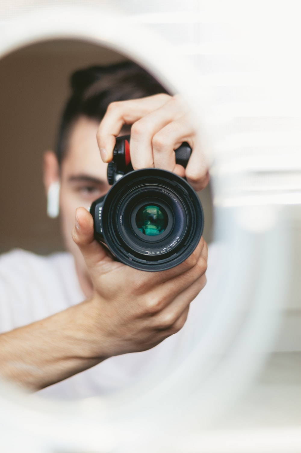 selective-focus photography of person holding bridge camera