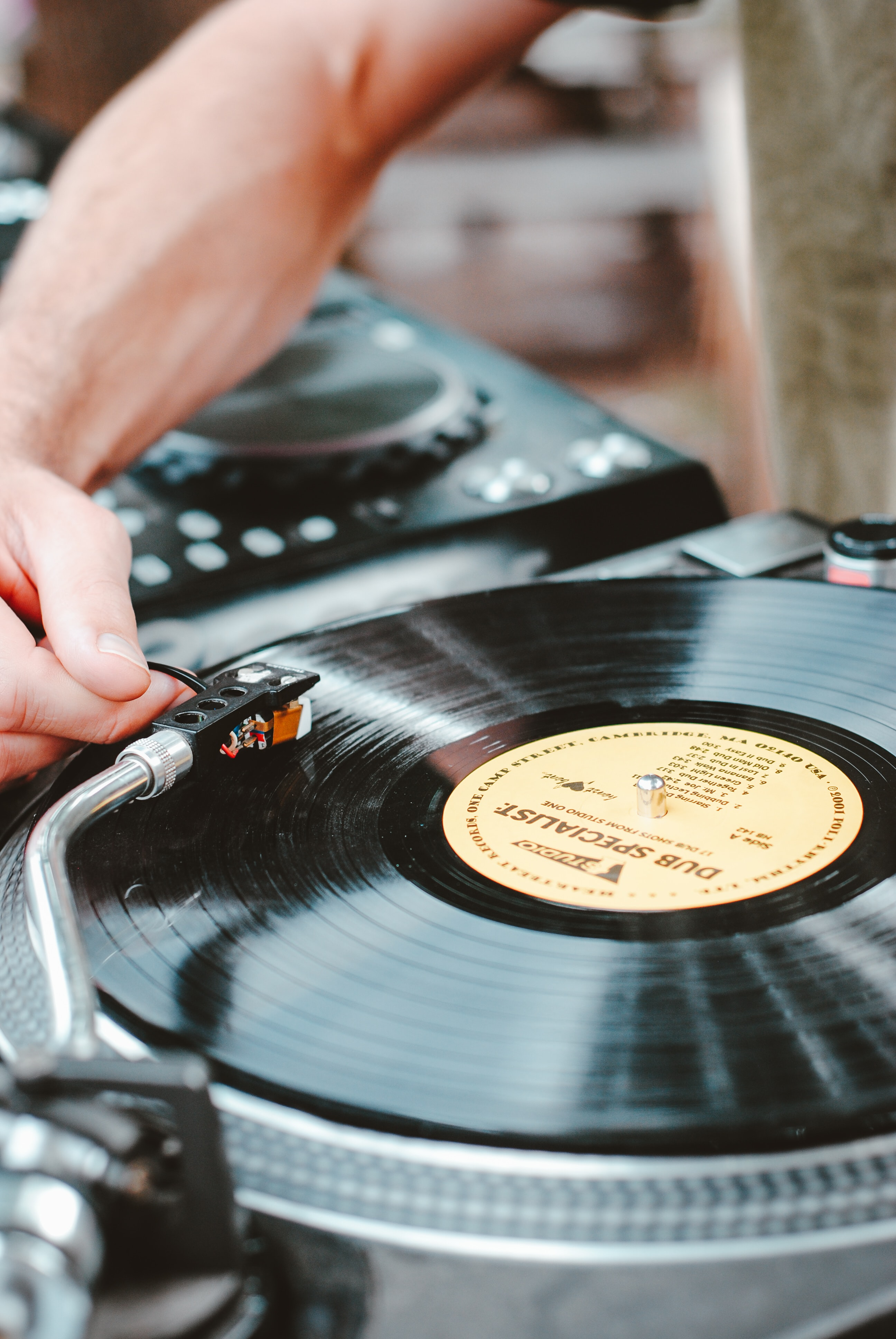 person playing turntable