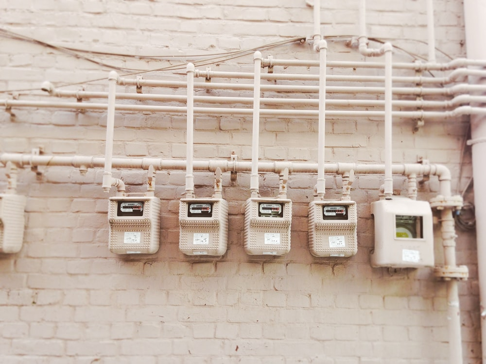 minimalist photography of beige painted electrical boxes