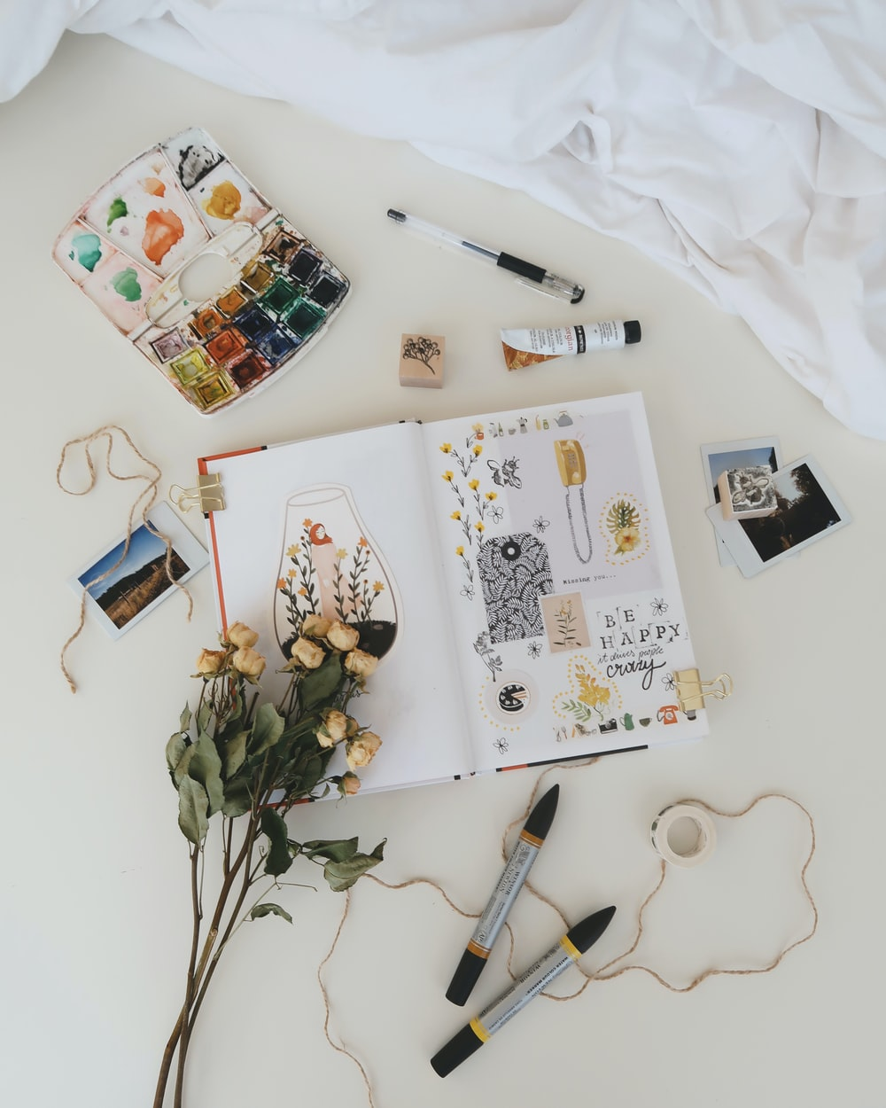 flatlay photography of stuffs on white surface