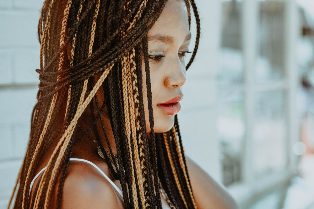 selective focus photography of woman with braided hair
