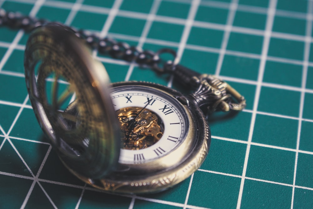 silver-colored pocket watch