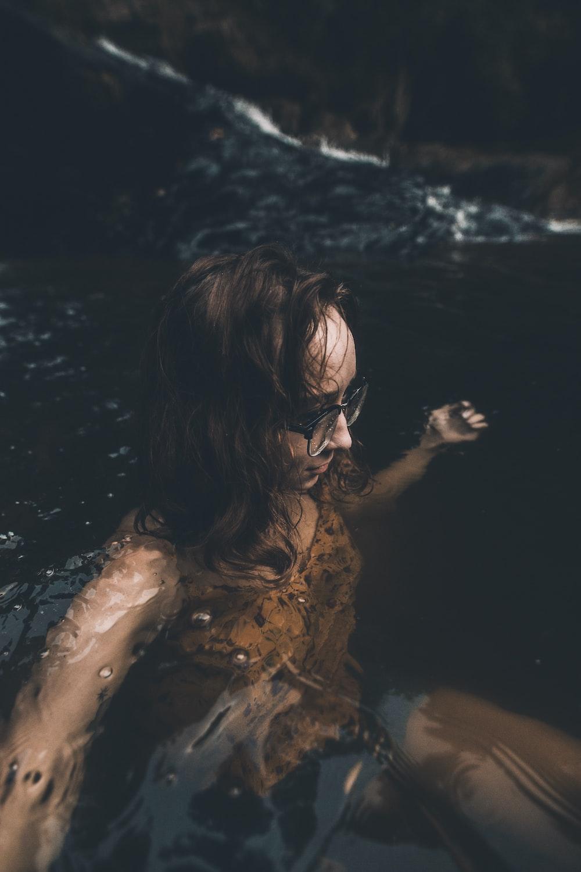 woman wearing eyeglasses at body of water