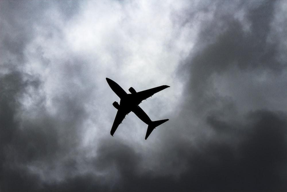 passenger plane under white clouds