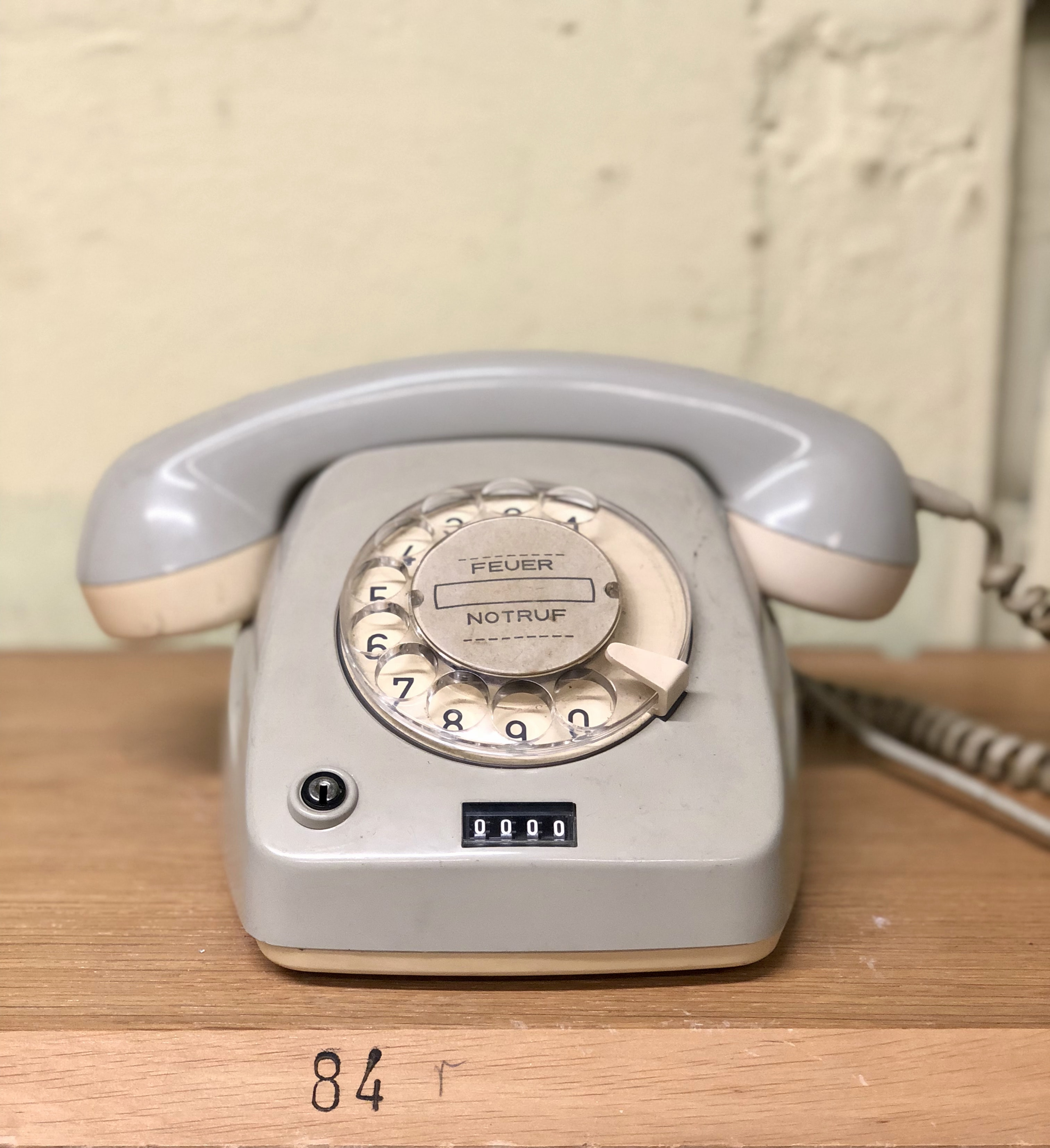 gray rotary telephone on brown table
