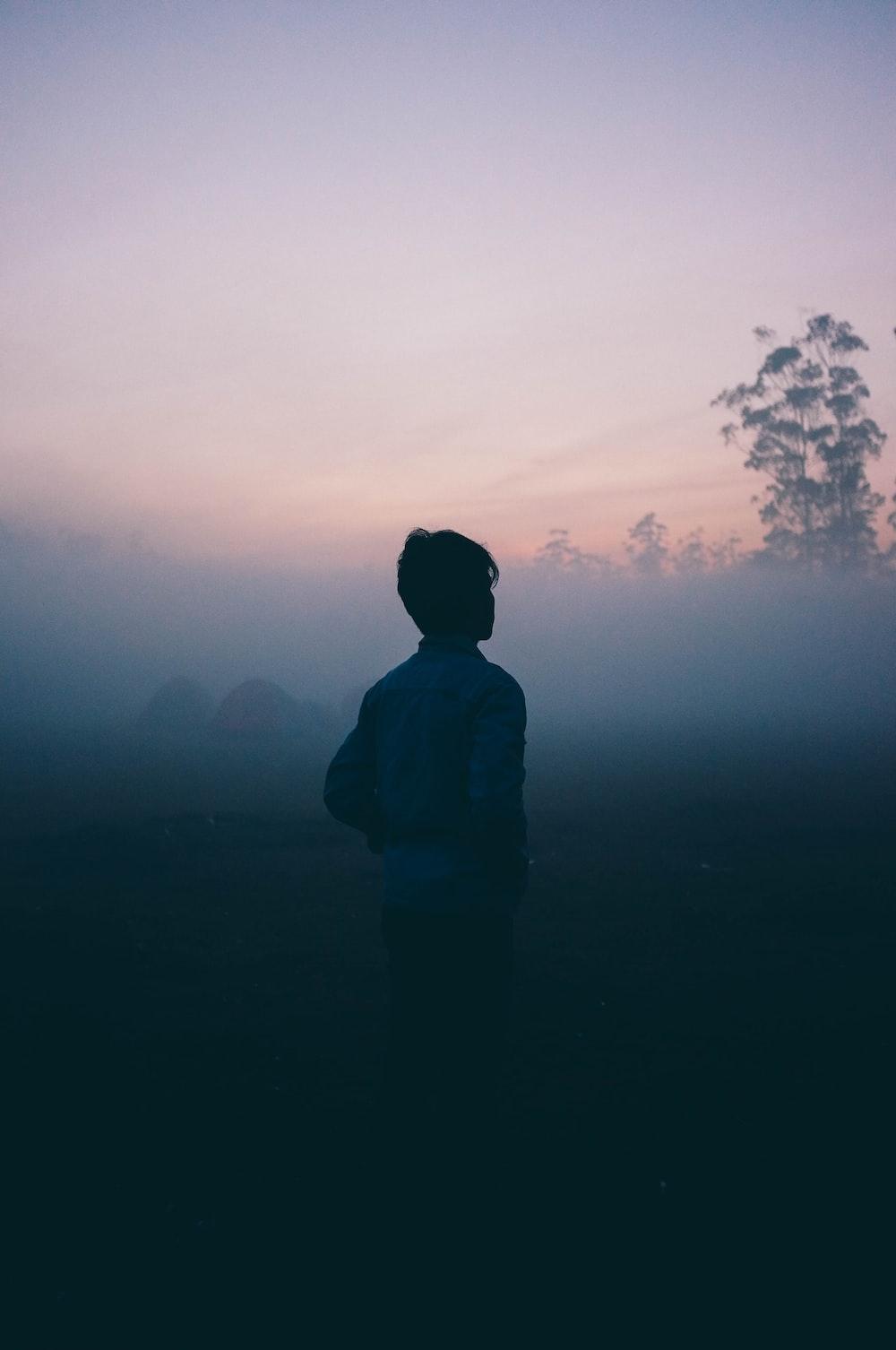 a man walks alone in the haze