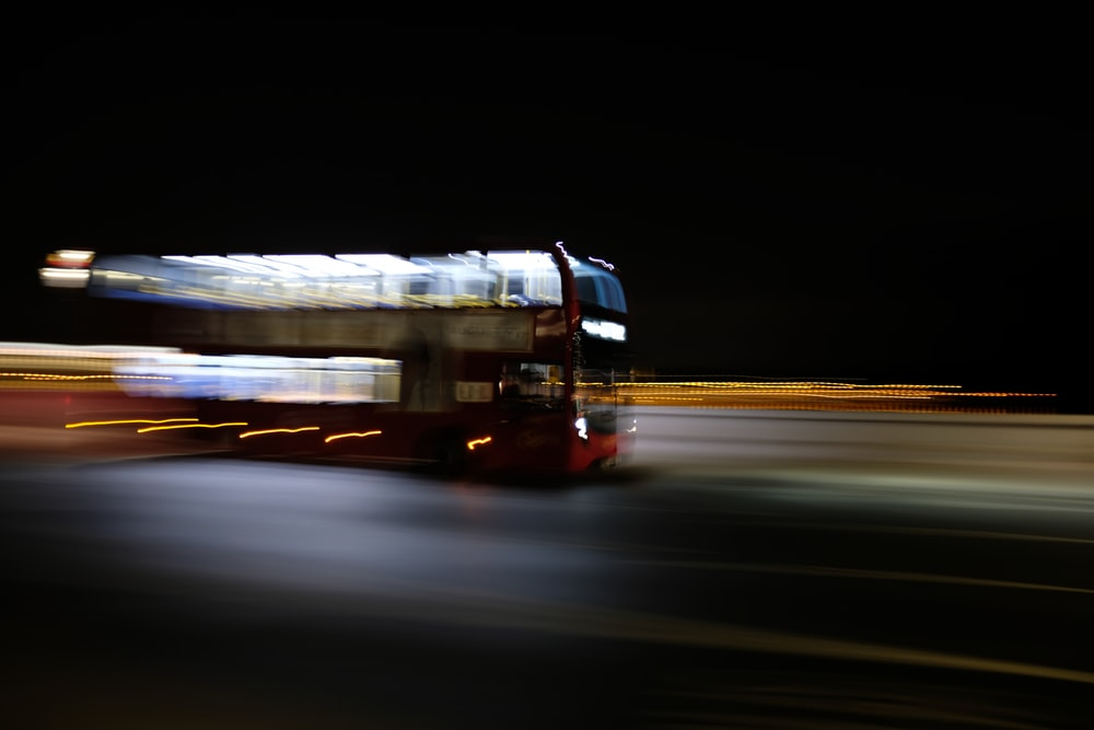 motion blur photography of double decker bu