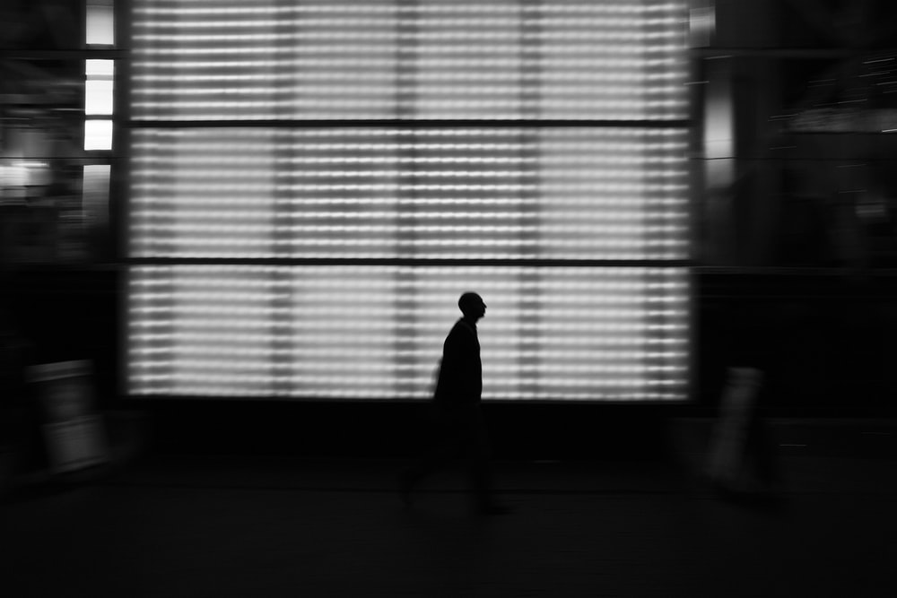 silhouette of person near white LED light