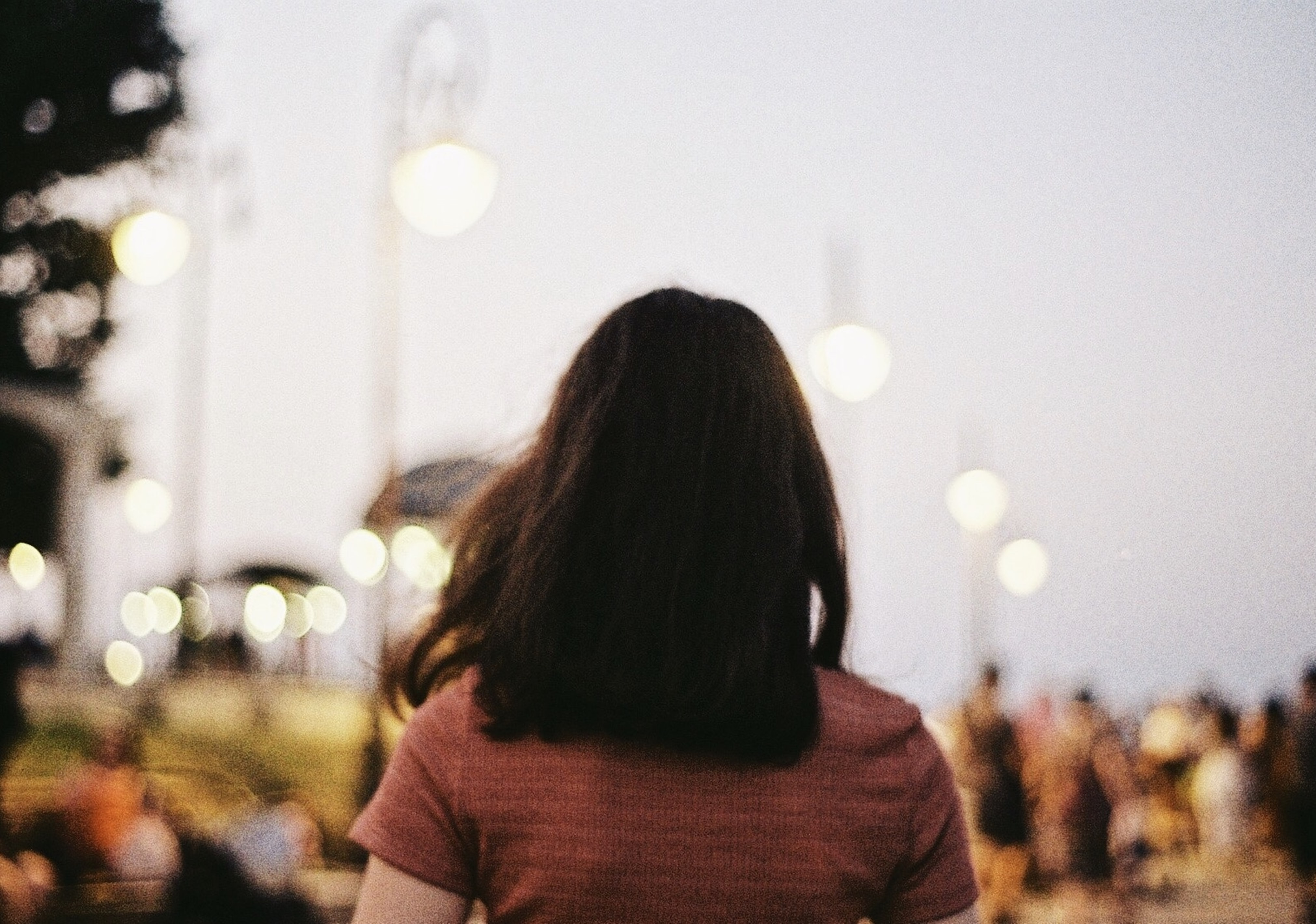 woman in brown T-shirt in shallow focus photography