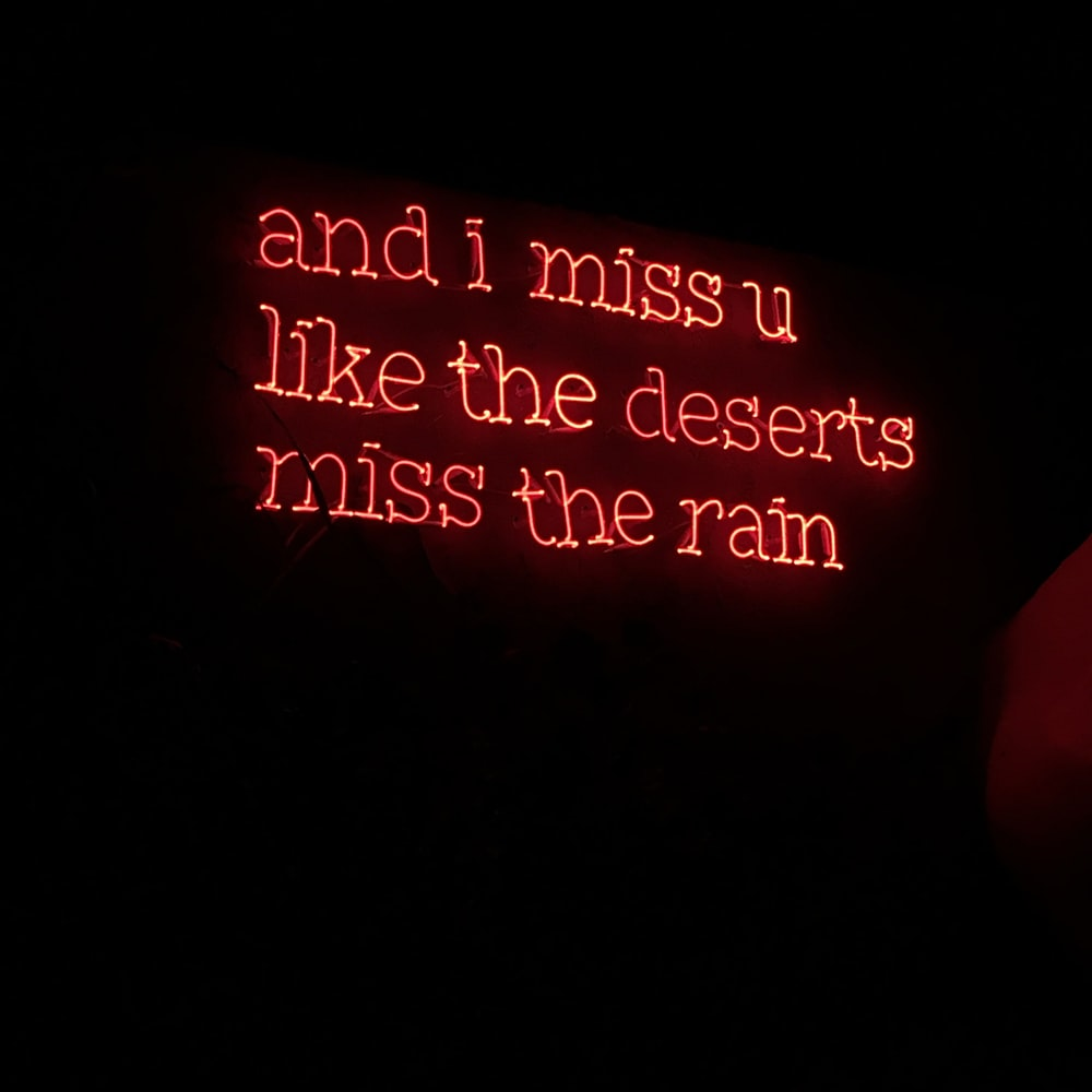 and i miss u like the deserts miss the rain text illustration