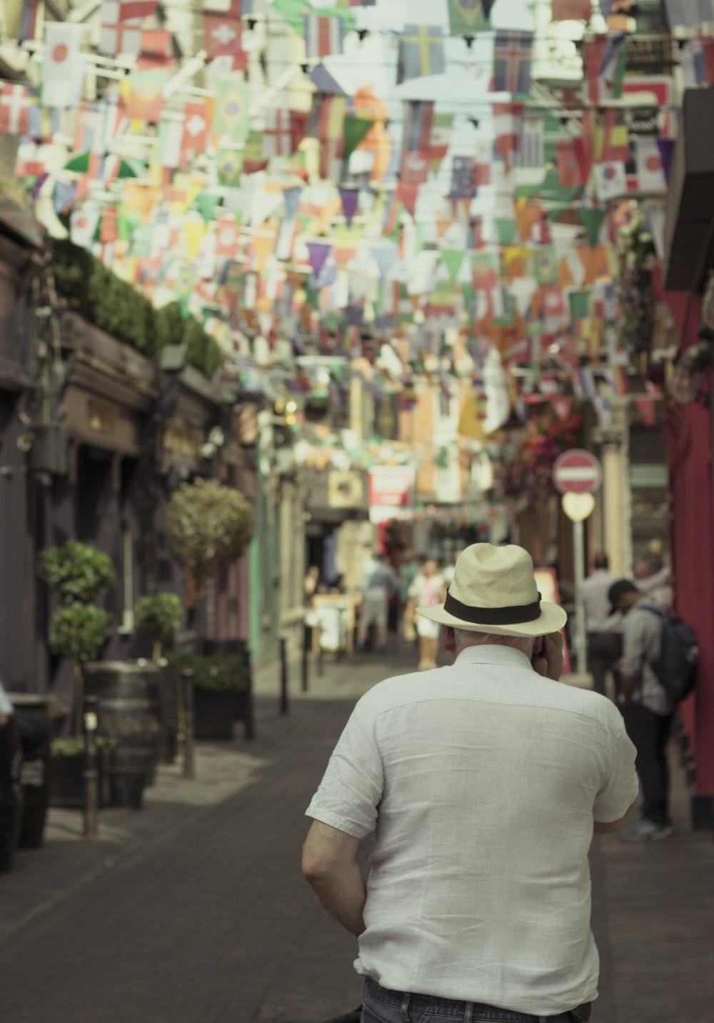 man walking on city street at daytime