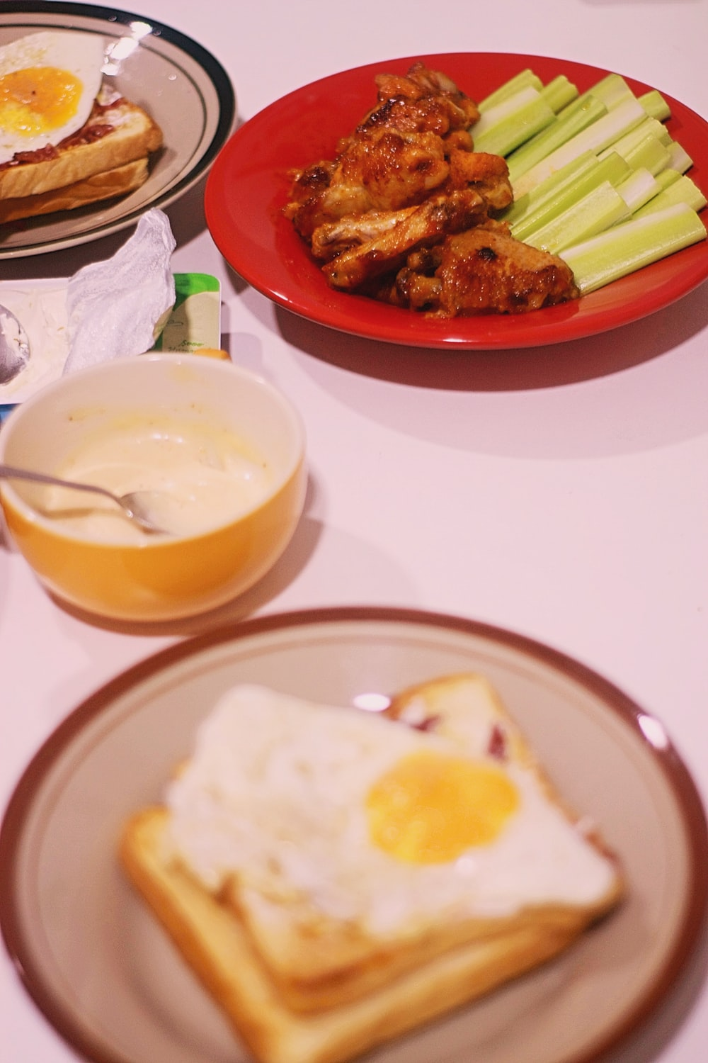 grilled meat with fried egg and bread