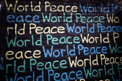 world peace text printed on wall humanity teams background