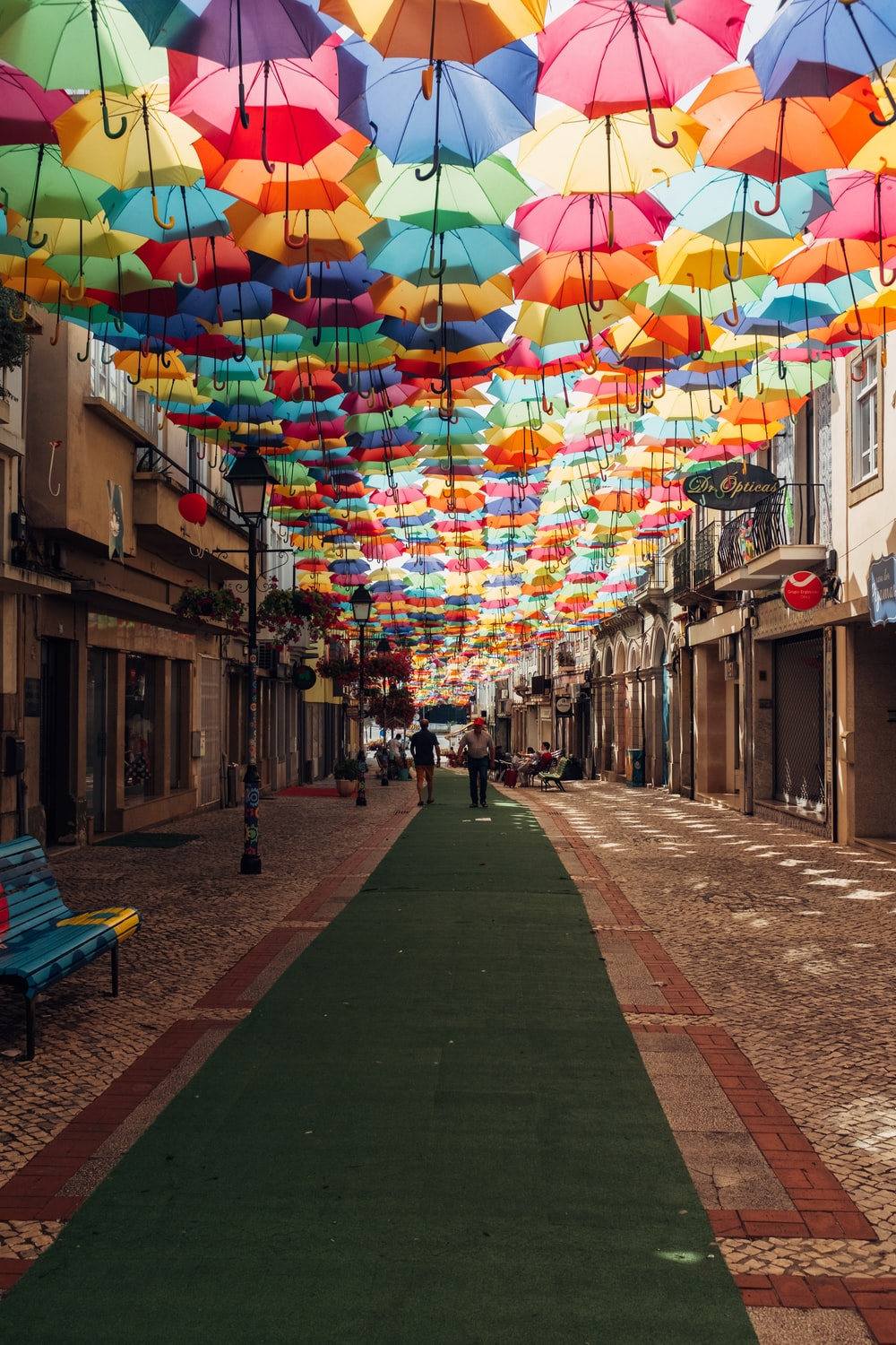 assorted-color umbrella covering alley during daytime