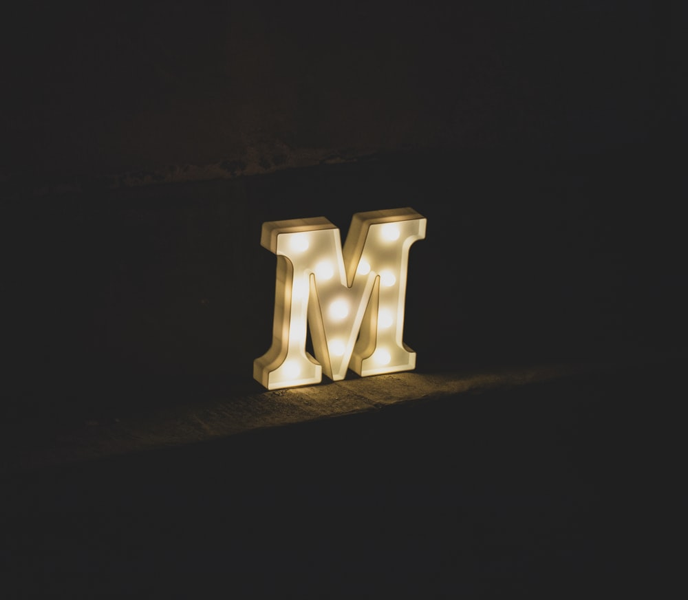 white M marquee letter signage