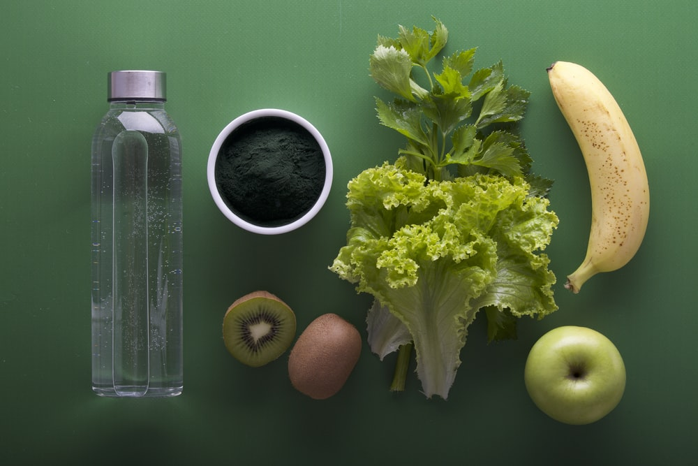 assorted fruits and vegetables on green surface