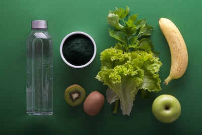 assorted fruits and vegetables on green surface health teams background