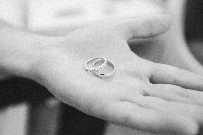 wedding bands grayscale photo