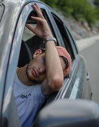 man sitting inside car