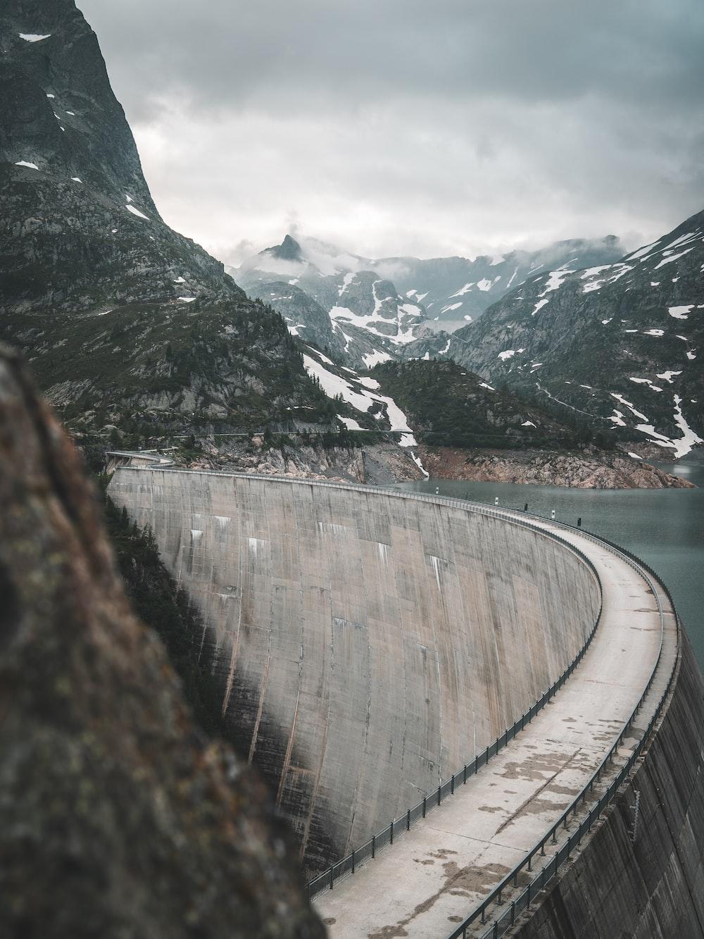 close up photography of dam near mountain