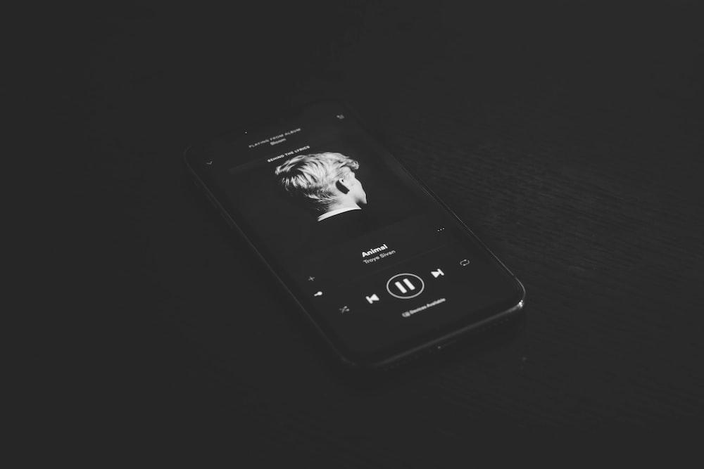 grey smartphone playing music