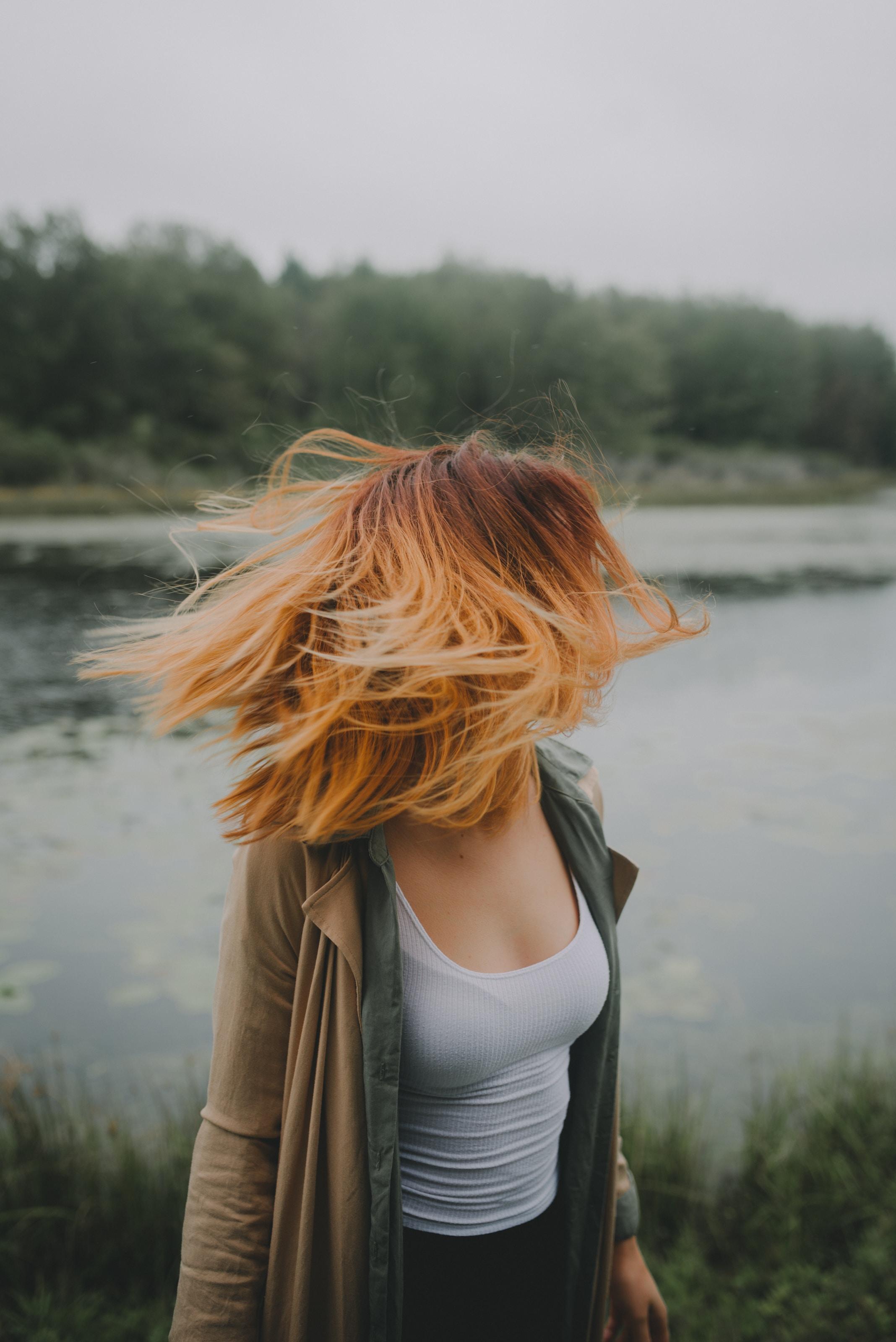 woman looking back near river