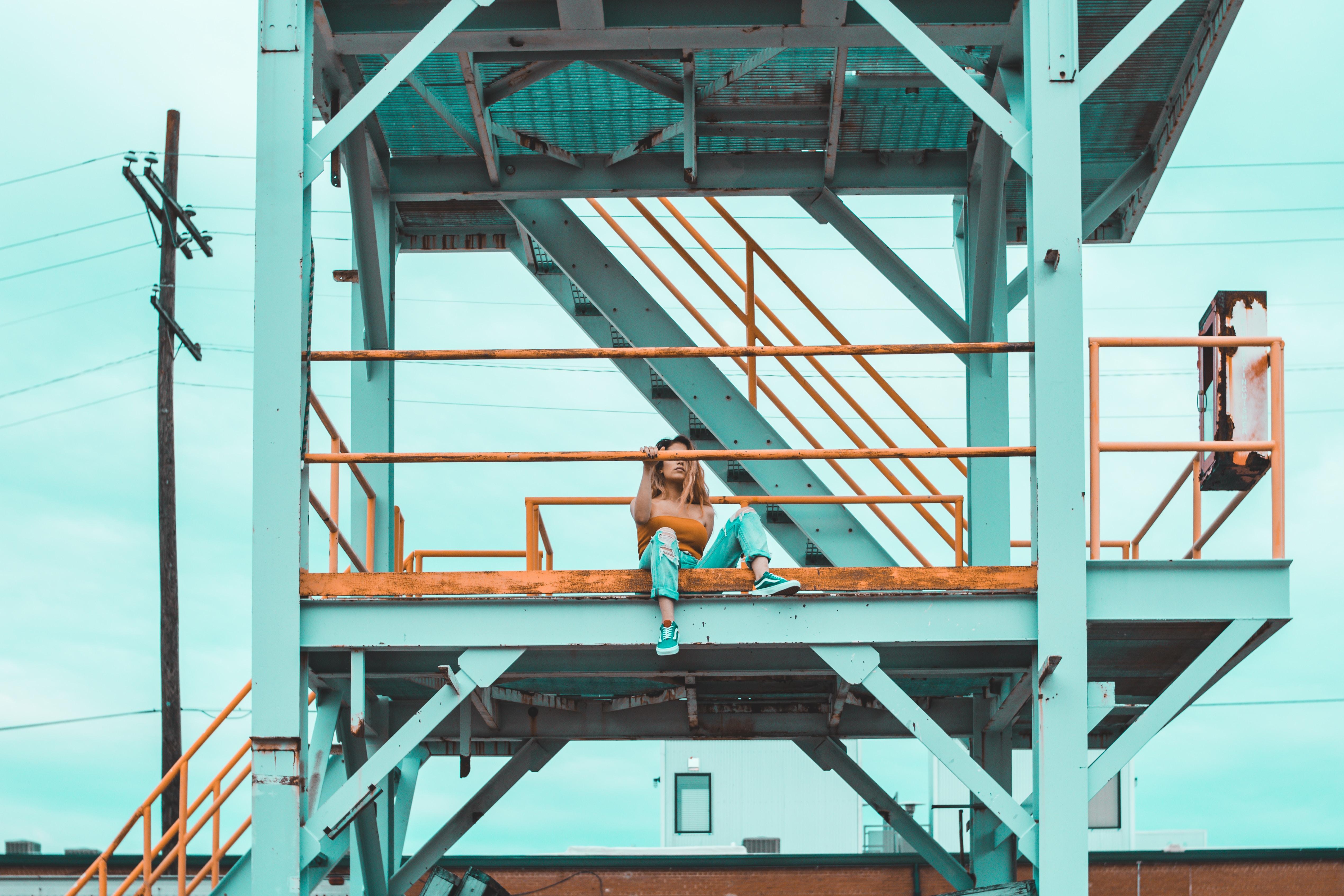 woman sitting on balcony