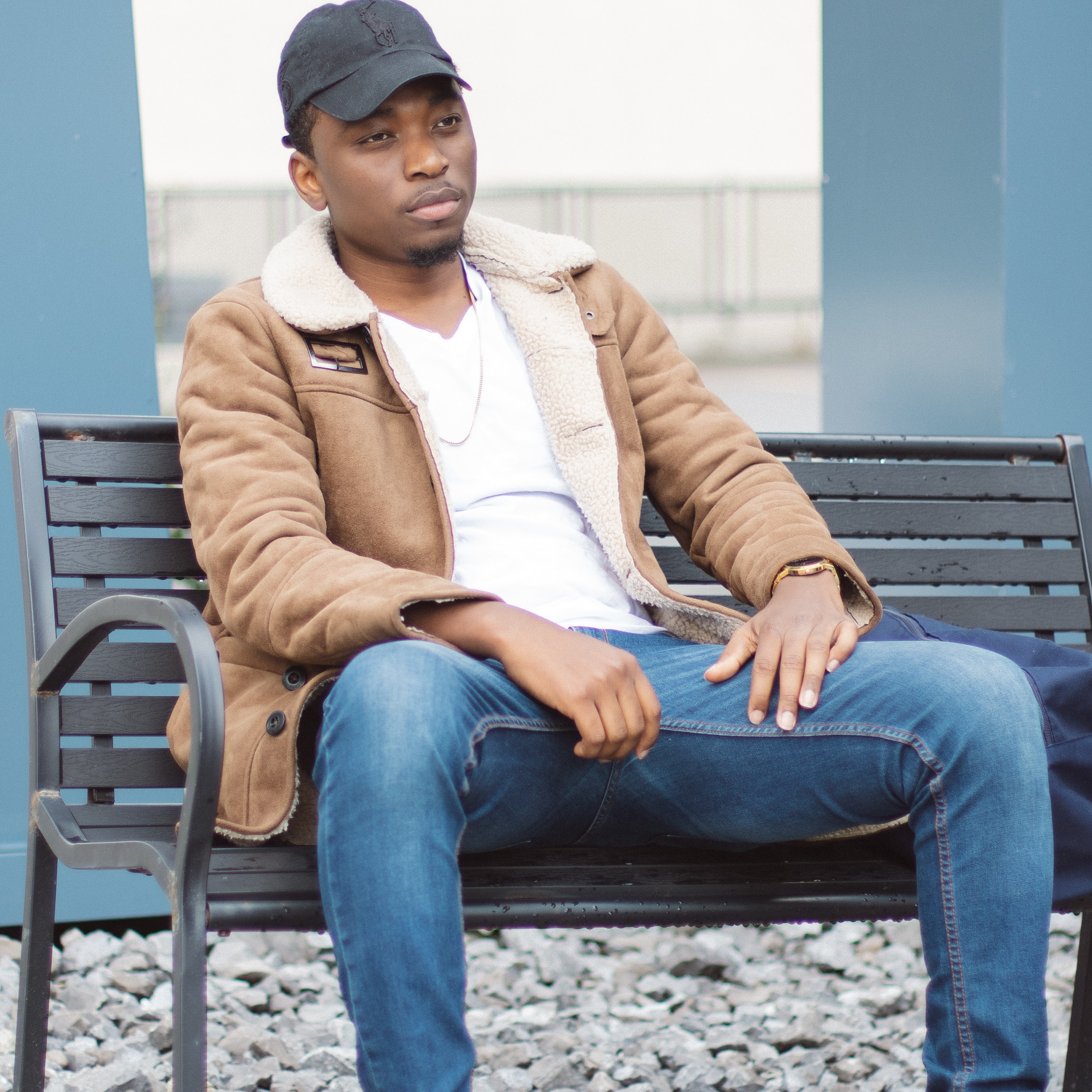 men's brown leather coat and blue denim jeans