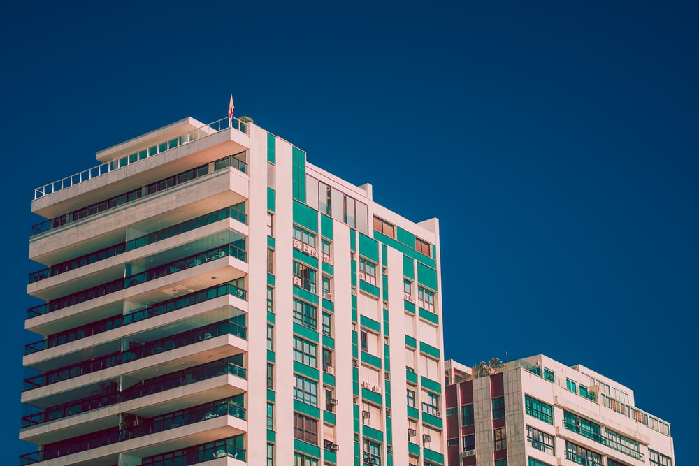 white and green high-rise building