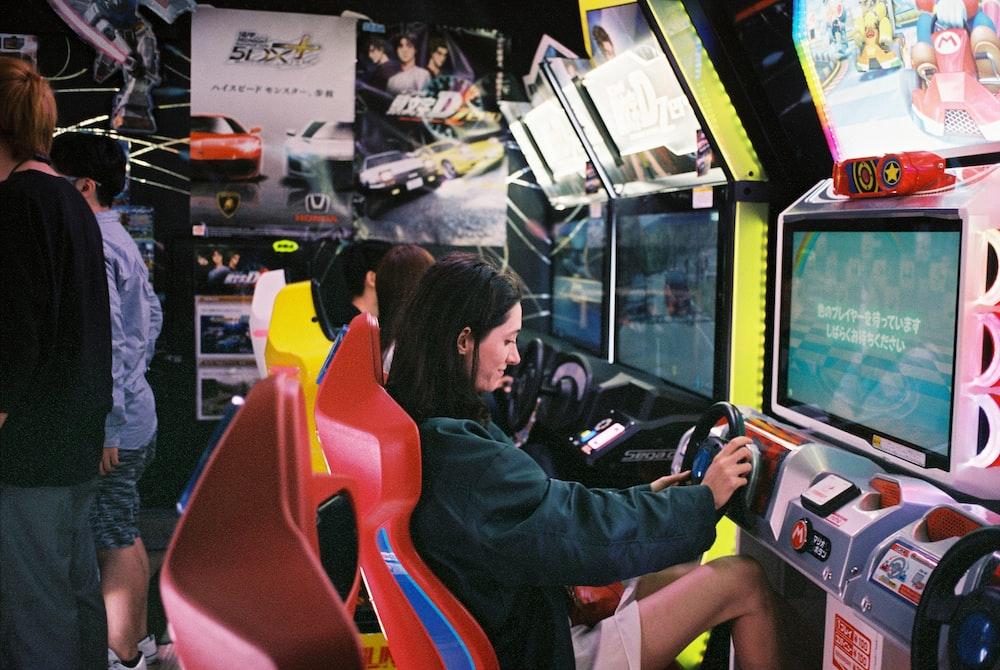 woman driving arcade machine