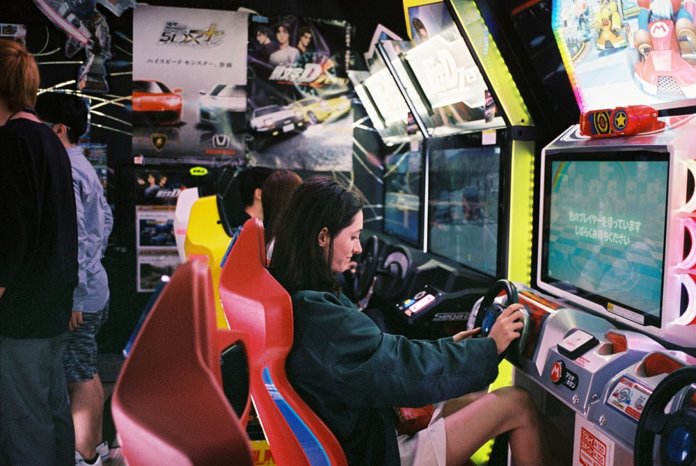 woman driving arcade machine