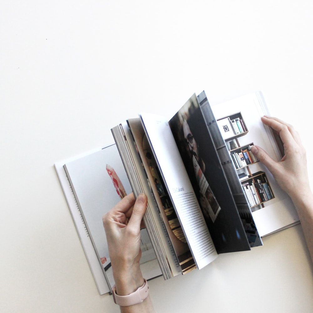 flat lay photography of opened book