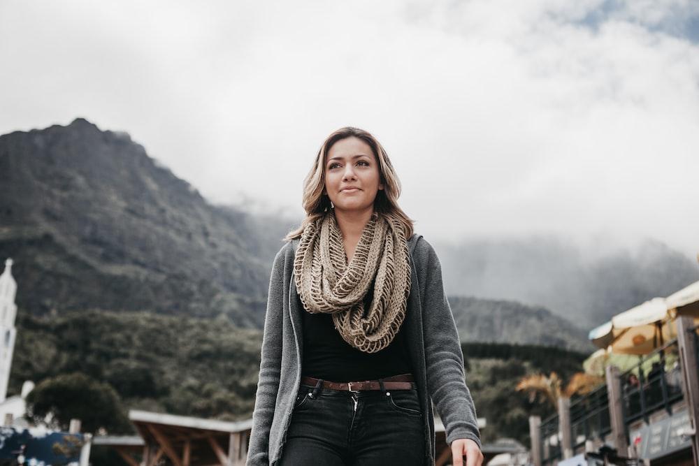 woman wearing gray cardigan and brown scarff