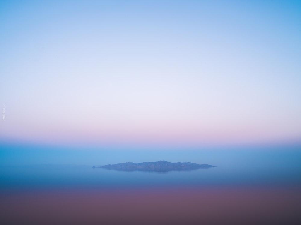 island under clear blue sky
