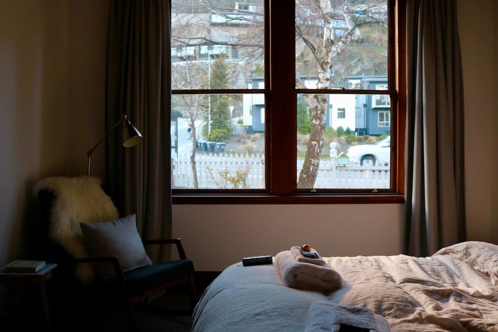 gray gooseneck lamp beside window
