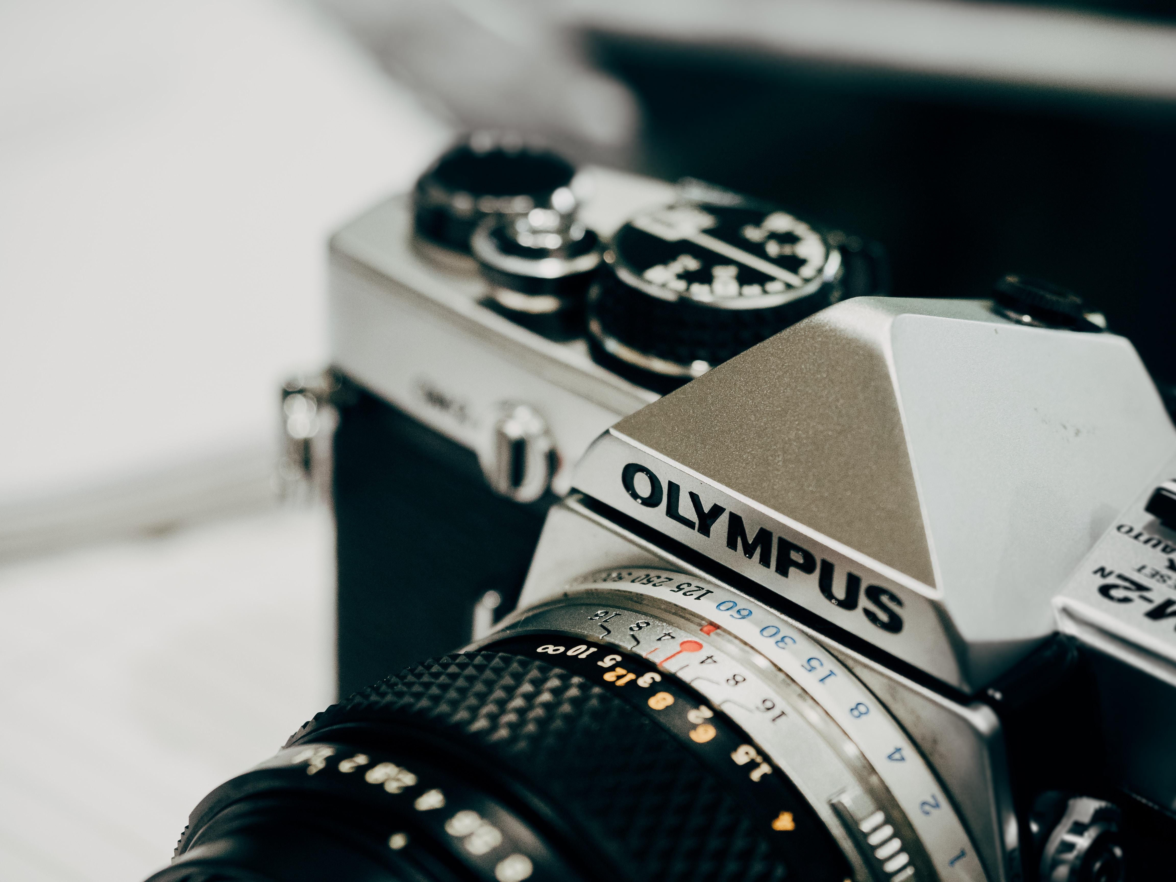 closeup photography of black and gray Olympus camera