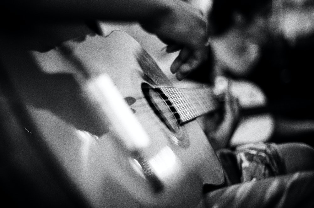 grayscale of acoustic guitar