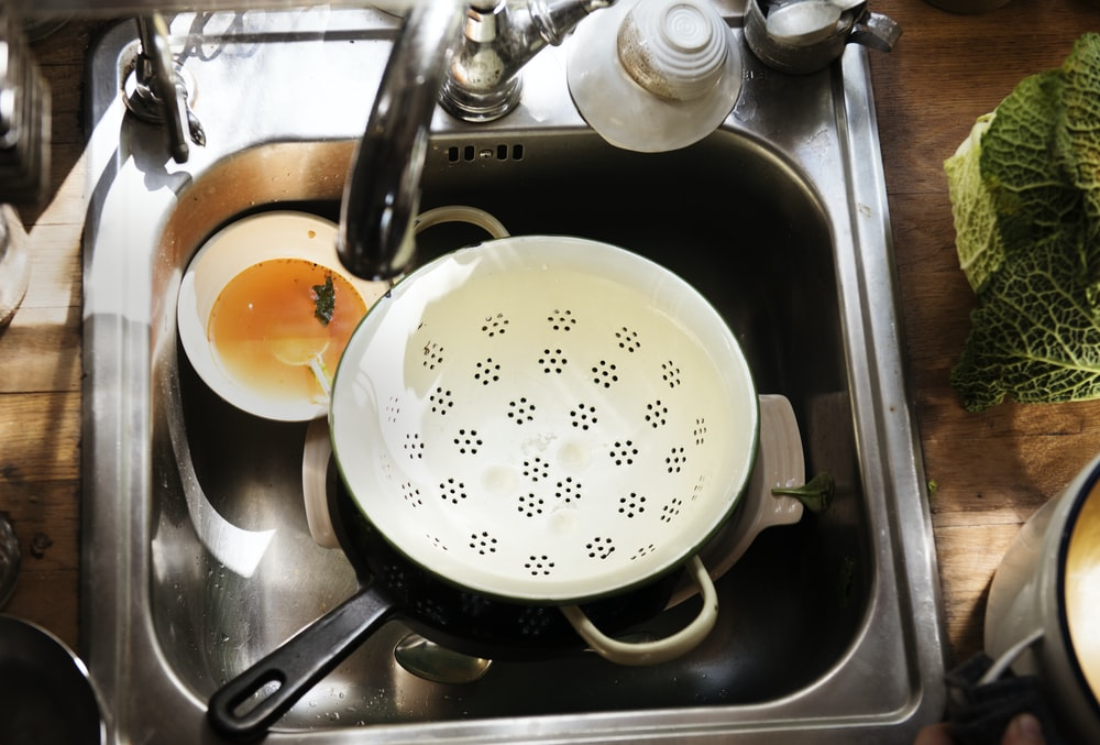 white ceramic strainer in sink