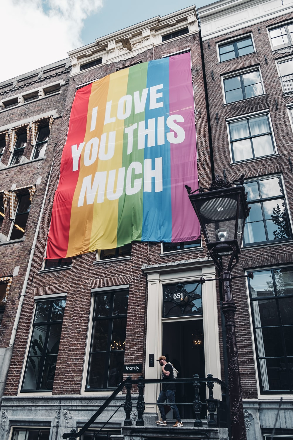 I love you this mush poster hanged on brown painted building