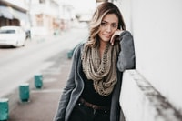 women's brown scarf and gray jacket