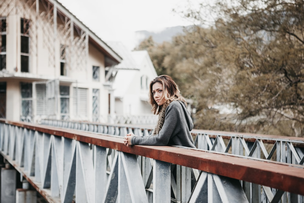 woman leaning on rail