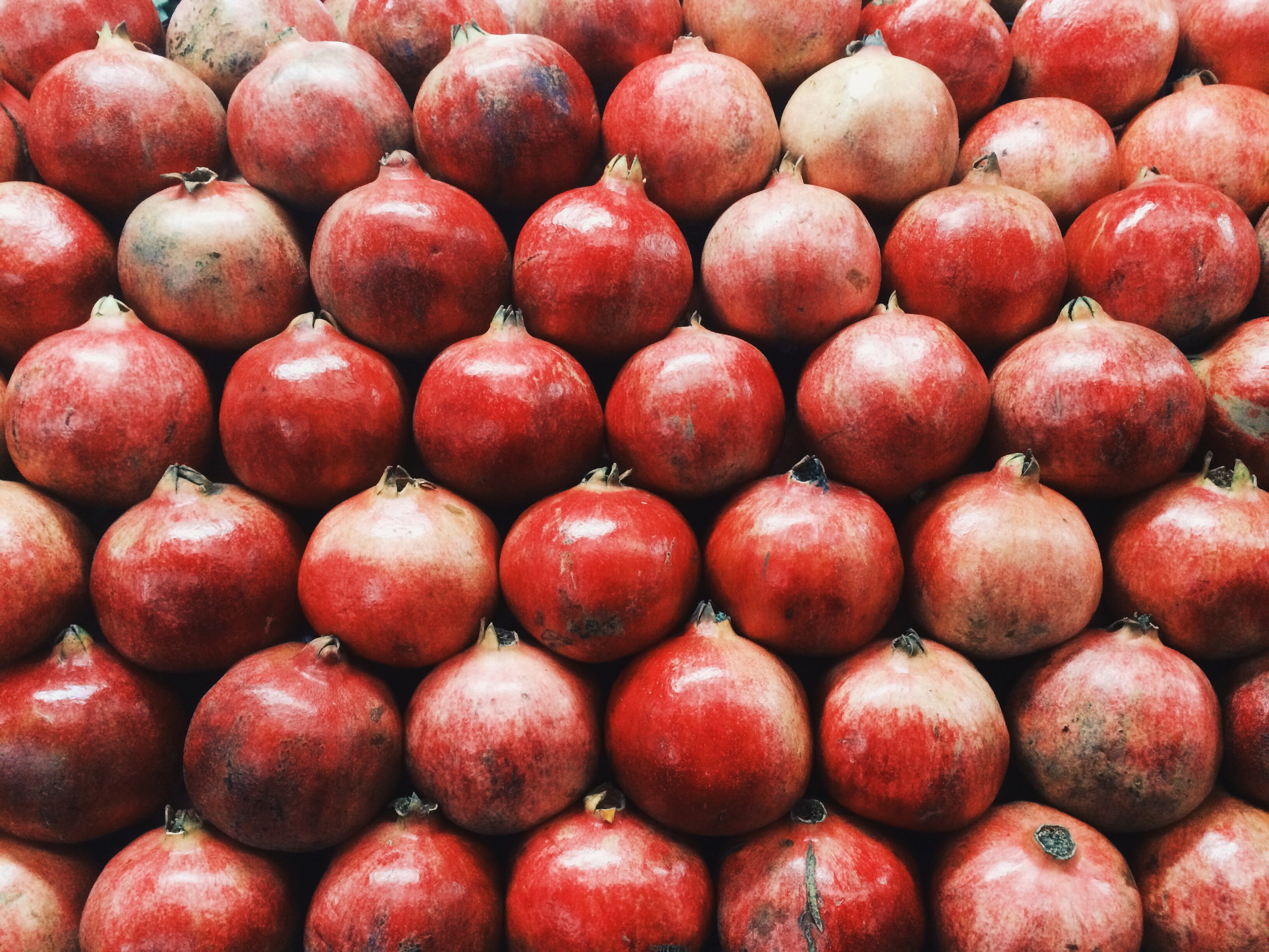 bunch of pomegranate fruits