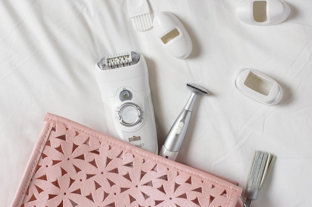 white shaver on white textile