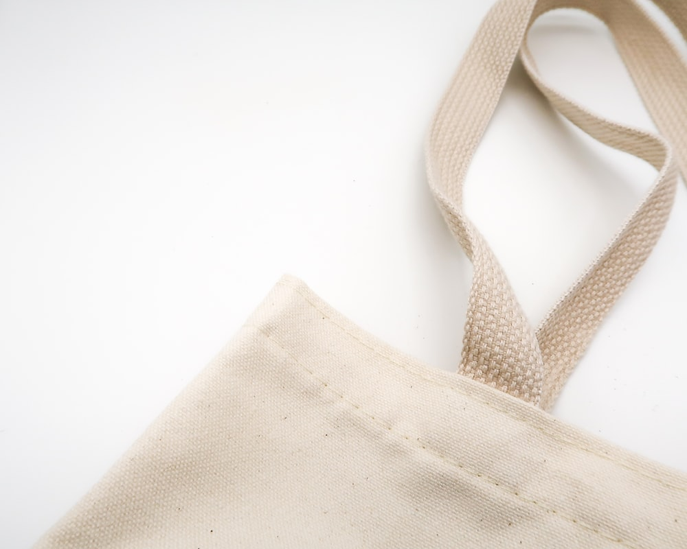 brown tote bag on white surface sustainable procurement Winnipeg Metropolitan Region