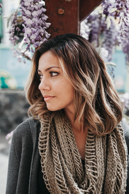 woman wearing gray scarf
