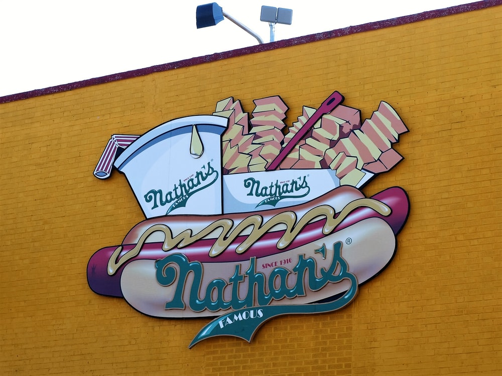 Nathan's food signage on yellow wall